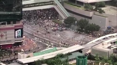 Hong Kong police fire tear gas into crowd of protesters