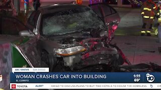 Woman taken to hospital after car crashes into building