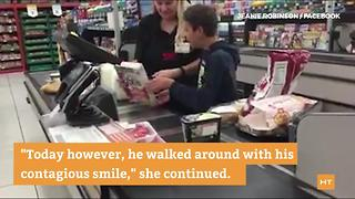 Cashier's act of kindness brings smile to teen with cerebral palsy - Video