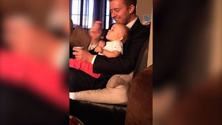 Dad Gets Distracted While Feeding Baby