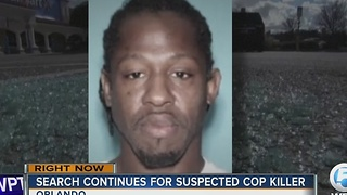 Search continues for suspected cop killer - Video