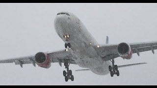 Airplanes Battle Against Snowstorm in Sweden - Video