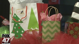 Volunteers delivering gifts to children in need - Video