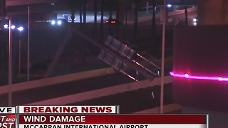 Fallen sign blocks road to McCarran Airport - Video