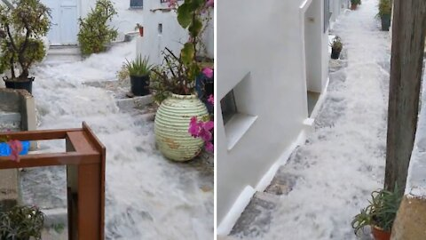 Flooding in Greece flows down stairs like an urban waterslide