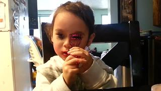 Girl gets caught using mommy's makeup, continues to apply it