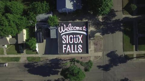 Sioux Falls citizen uses 1600 square foot roof to welcome visitors!
