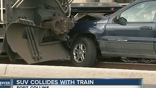 SUV collides with train in Old Town Fort Collins - Video