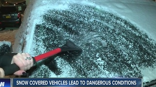 Snow covered vehicles lead to dangerous driving conditions - Video
