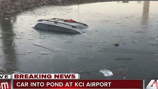 Car into pond at KCI Airport - Video