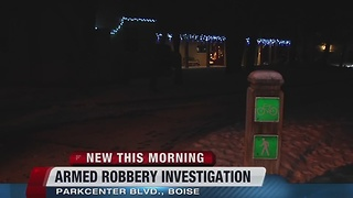 Police searching for armed robbery suspect - Video