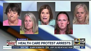 Police identify five arrested after protests at Sen. Flake's office.