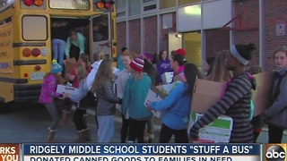 Ridgely Middle School students collect canned goods to 'Stuff a Bus' - Video