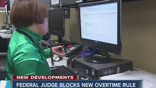 Federal judge blocks new overtime rule - Video
