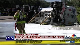 Crews work to clean up taker crash and fuel spill - Video