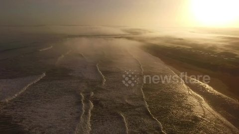 Drone captures beautiful foggy sunset in Northern Ireland coast