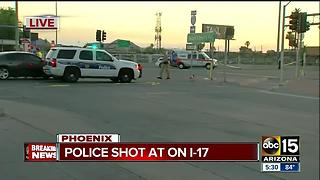 Phoenix police officers shot at near I-17 - Video