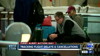 Hundreds of flights canceled as storm moves in
