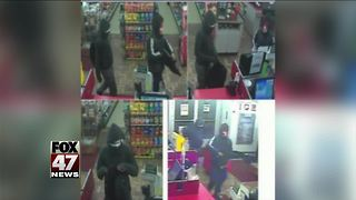 Pictures released of 2 men who robbed QD - Video