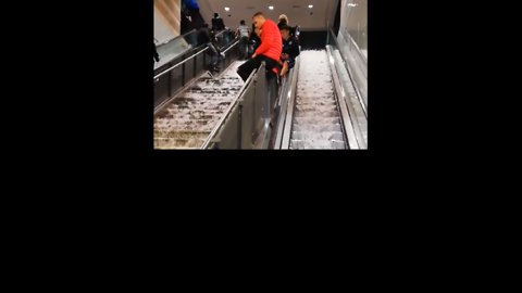 Hail and Floodwater Cascade Down Escalator at Rome Metro Station