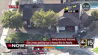 Fire crews battle house fire in Peoria - Video