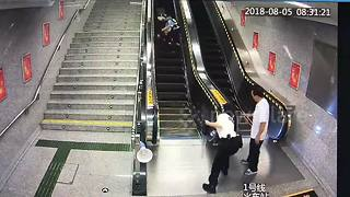 Policewoman dashes to save elderly lady tumbling down from an escalator