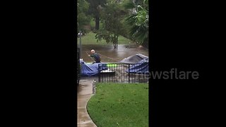 Resident kayaks through waterlogged street to rescue neighbor's boat as severe flooding hits Central Texas - Video