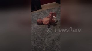 Diapered baby attempts his first somersaults all by himself