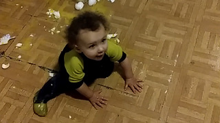 A Girl Hilariously Struggles To Stand Up On The Kitchen Floor - Video