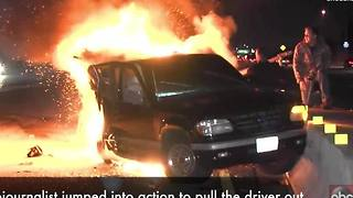 WATCH | Cameraman heroically pulls man from burning car - Video