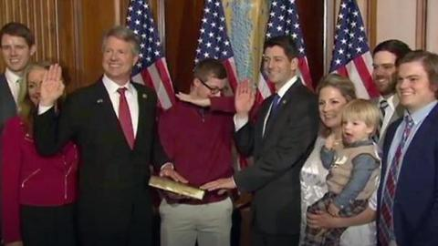 """Teen """"Dabs"""" At Father's Swearing In"""