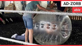 Man too fat to stand-up in big inflatable Zorbing ball
