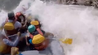 Dramatic Footage Shows White Water Rafting Trip Being Rescued After Their Boat Is Tipped Over