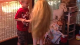 A Little Boy Dances and Kisses A Life Size Doll On A Trampoline