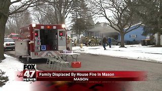 Crews battle house fire in Mason