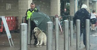 Officer Protects Dog From Rain