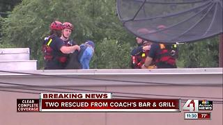 Owners of Coach's Bar & Grill rescued from rooftop - Video