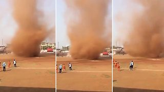 Sand tornado interrupts cricket game - Video