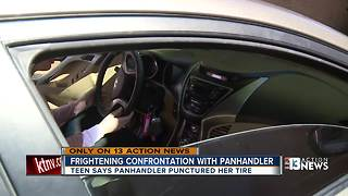 Woman says panhandler punctured her tire - Video