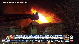 50 firefighters and a Marine helped families escape an apartment fire - Video