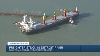 Canadian and US officials are working to get a stuck freighter free in the Detroit river.