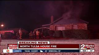 Firefighters battle house fire in North Tulsa - Video