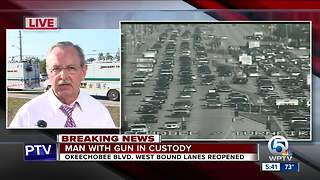 Man with gun in custody - Video