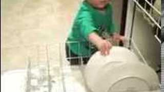 Capable Toddler Happy to Help Out in the Kitchen - Video