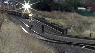 Freight Train Narrowly Misses Youths Playing on Tracks - Video