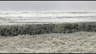 Irish coastal town gets covered in sea foam after Storm Ophelia - Video
