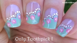 Wavy side French manicure with flower design