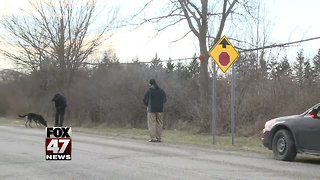 Police ID body found along road - Video