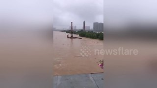 Piledriver washed away by floods crashes into bridge - Video