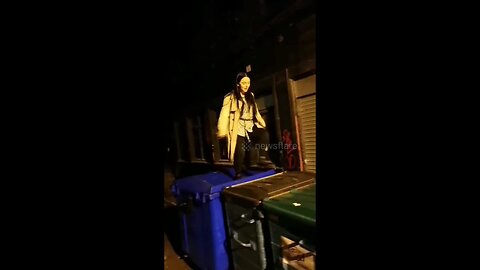 UK woman running across bins fails and slips into the rubbish